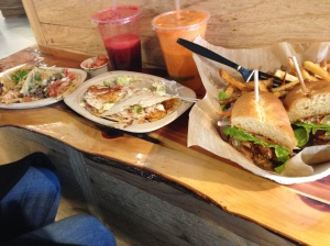 Tacos, juice, and Soft shell crab Po Boy.